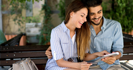 Happy couple doing shopping on internet