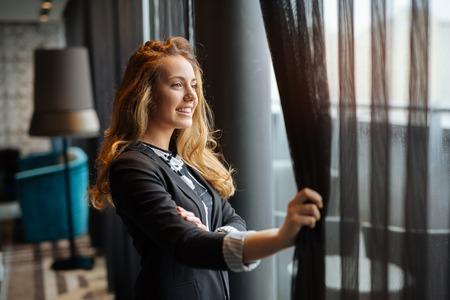 Glamorous woman  staring through window Stock Photo