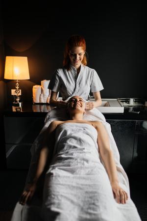 Beautiful woman enjoying massage Zdjęcie Seryjne