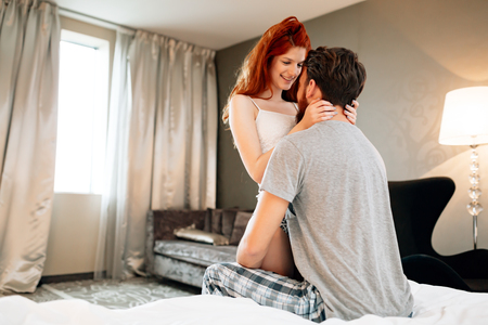 Sensual foreplay by couple Stock Photo