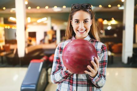 Woman throwing bowling ball