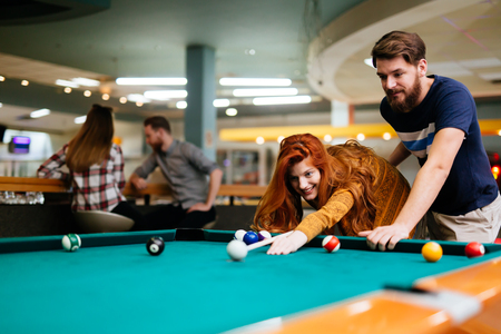 Couple spending time together by playing pool
