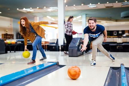 Friends bowling at club Archivio Fotografico