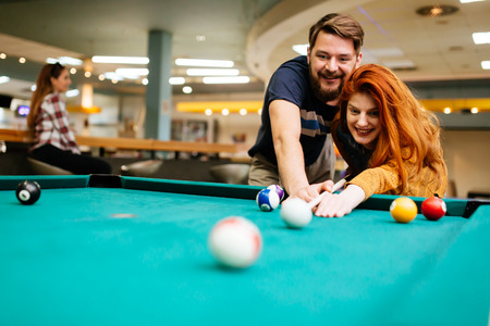 Couple playing billiards Stock Photo