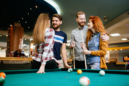Group of people playing snooker Stock Photo