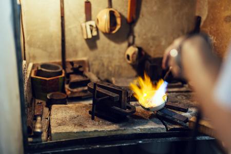 Goldsmith melting metal Фото со стока - 90454842