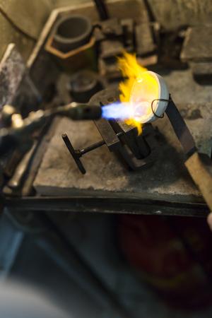 Jeweler melting gold Фото со стока - 90454845