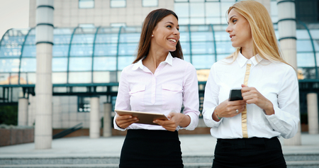 Picture of two young beautiful women as business partners