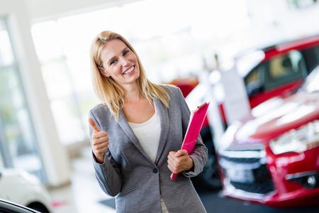 Picture of professional salesperson working in car dealership Imagens