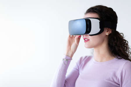 Young excited woman trying virtual reality headset Stock Photo