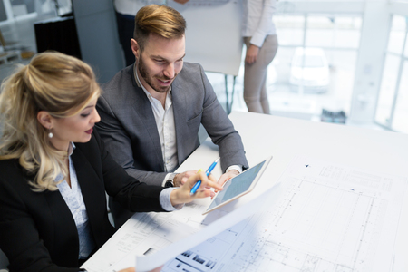 Two young architects working together in office