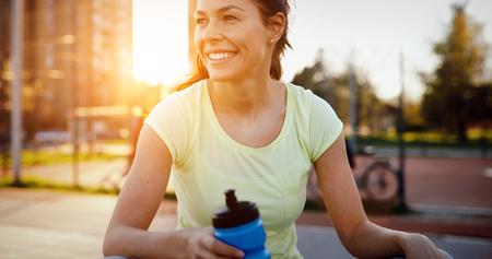 Thirsty sportswoman doing her jogging training Stock Photo