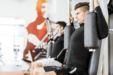 Young handsome men working out in a  gym