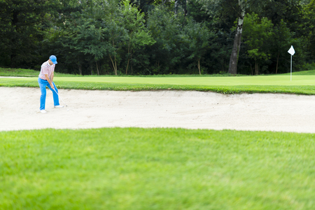 Golfer taking a bunker shot Stock fotó