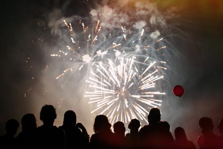 Crowd watching fireworks Фото со стока