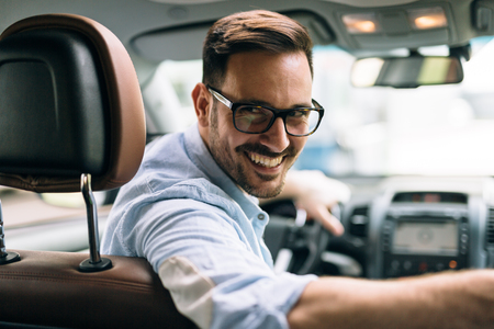 Portrait of a businessman driving car Stock Photo