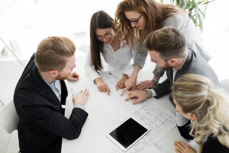 Business people and architects collaborating on project Stock Photo