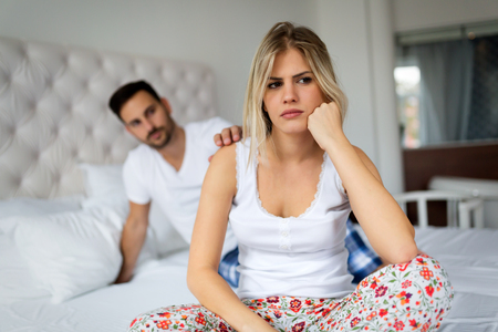 Young couple in bed having problems and crisis Stock Photo - 91942828