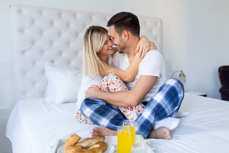 Couple enjoying one another while having breakfast Imagens