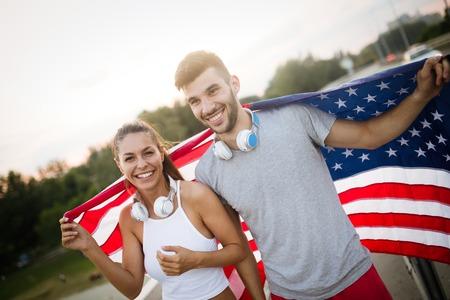 American flag - woman and man USA sport athlete winner cheering waving US flag
