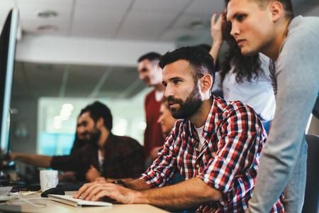 Portrait of programmers working in development software company