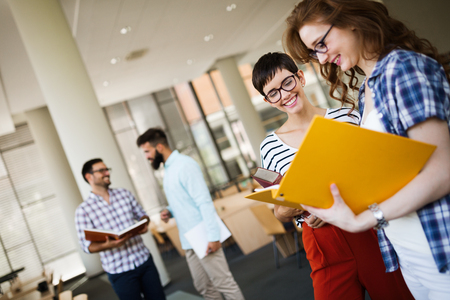 Group of college students studying at library Stock Photo