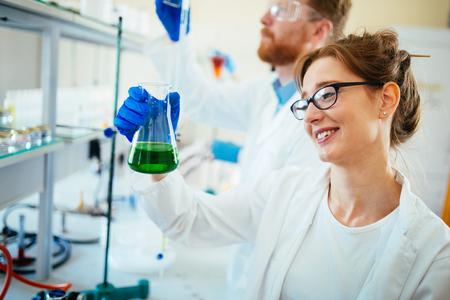 Group of scientists working at laboratory Zdjęcie Seryjne
