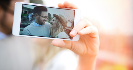 Happy couple having fun and taking a selfie Stock Photo
