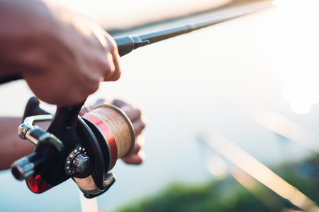 Fishing, hobby and recreational concept - fishermen