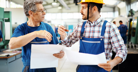 Team Of Engineers Having Discussion In Factory Stock Photo