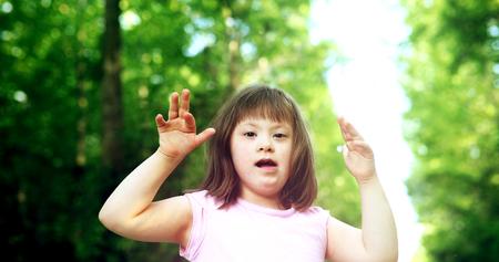 ダウン症候群の美しい少女の肖像 写真素材
