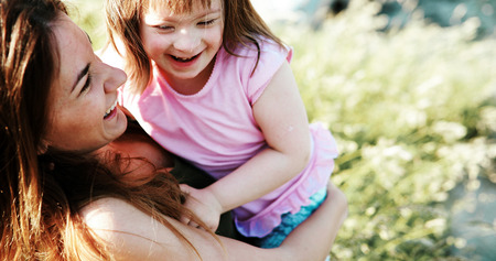 Little girl with special needs enjoy spending time with mother Foto de archivo