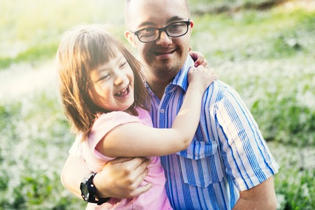 Picture of girl and man with down syndrome Stockfoto