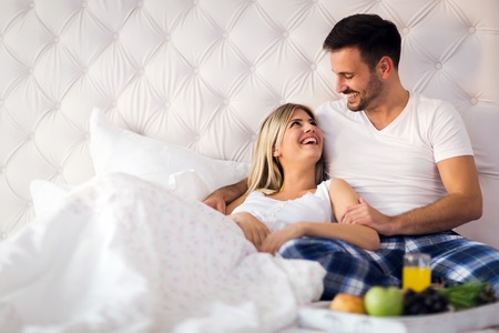 Young couple having having romantic times in bedroom