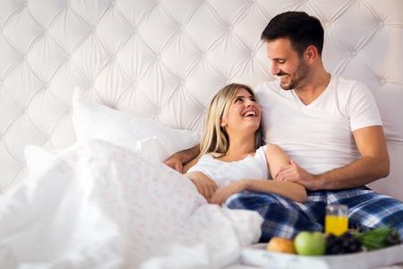 Young couple having having romantic times in bedroom 写真素材 - 95424009