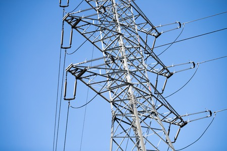 Picture of transmission line tower on blue sky