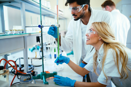 Group of scientists working at laboratory Stock Photo