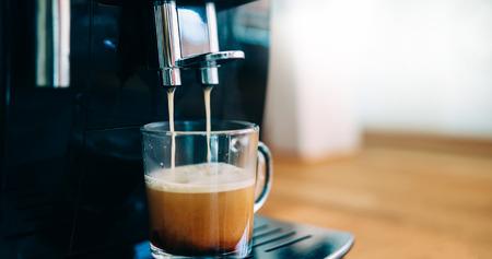 Coffee machine making coffee in morning with crema