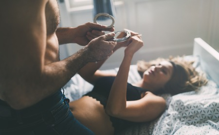Woman and man playing domination games in bed Stock Photo - 97237083