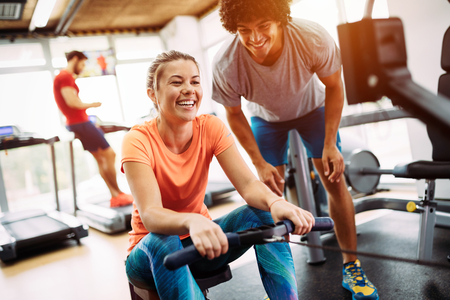 Young beautiful woman doing exercises with personal trainer Stock fotó