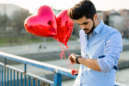 Sad man waiting for date on valentine date Standard-Bild - 97273033