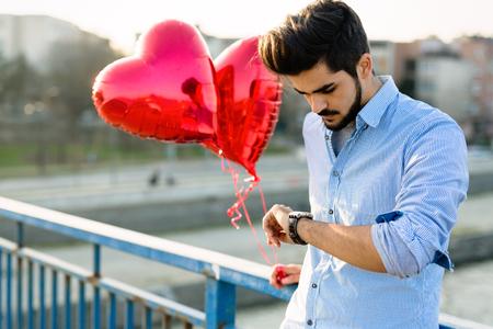 Sad man waiting for date on valentine date Archivio Fotografico - 97273033