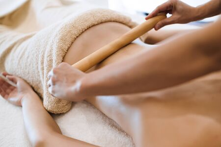 Thai massage therapist treating patient Stock Photo