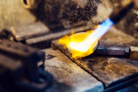 Jeweler melting gold Stock Photo