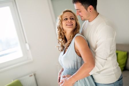Happy pregnant woman relaxing with her husband Stock Photo
