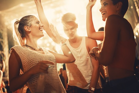 Group of friends having great time on music festival Stock Photo