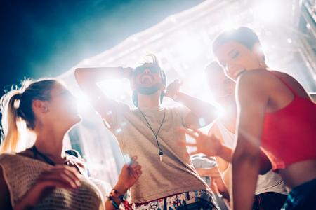 Group of friends having great time on music festival Reklamní fotografie
