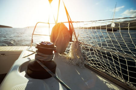 Sailboat with winch and rope on deck Stock Photo - 99076340