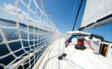 Portrait of sailing boat on open sea