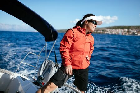 Attractive strong woman sailing with her boat Stockfoto - 99422489